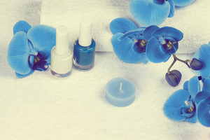 Place for manicure, decorated with blue orchid flower