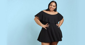 Plus size model in studio shoot happy smiling