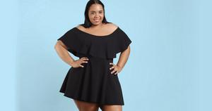 Plus size model in studio shoot happy smiling