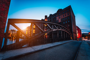 Poggenmuehlen Bridge at dawn. Hamburg, Germany. illuminated buildings and last sunrays. Warehouse District Speicherstadt Landmark of HafenCity quarter. Most visited touristic famous place