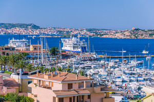 Port of Palau on sardinia island with farry and yacht boats. La Maddalena island in background