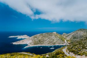 Porto Vromi on Greek Zakynthos island. Blue sea bay surrounded by barren cliffs. Greece