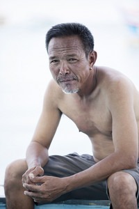 portrait face of asian senior man looking to camera