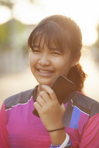 portrait face of asian teenager happiness emotion with smartphone in hand