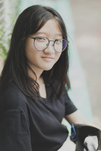 portrait headshot of asian wearing eye glasses smiling face