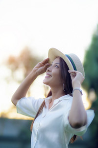 portrait headshot of beautiful asian woman toothy smiling face with happiness emotion standing outdoor