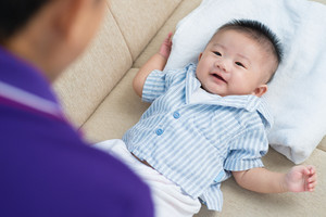 Portrait of a lying asian newborn on the sofa