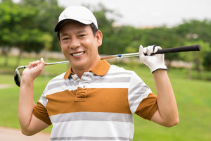 Portrait of a mature golf player smiling and looking at camera
