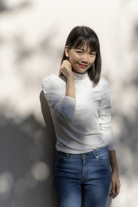 portrait of asian younger woman relaxing with smiling face standing outdoor