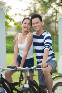 Portrait of beautiful Vietnamese couple on bicycles