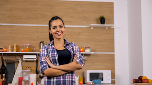 Portrait of beautiful wife cooking in her kitchen.