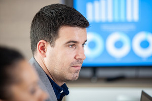 Portrait of businessman in conference room thinking about future