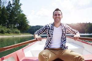 Portrait of cheerful men paddling