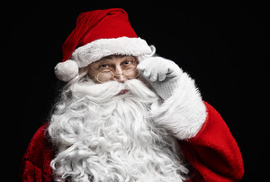 Portrait of cheerful santa claus with eyeglasses