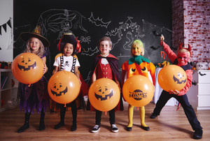 Portrait of children in costumes on halloween party