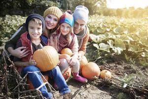 Portrait of family on pumpkin field