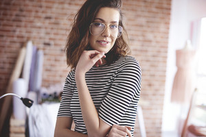 Portrait of fashion designer in pair of glasses