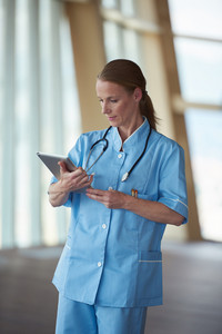 portrait of female doctor with  tablet computer at hospital