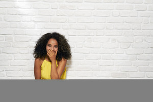 Portrait of happy black woman smiling and looking at camera. Copy space
