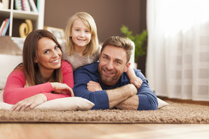 Portrait of loving family on carpet