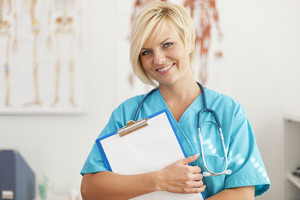 Portrait of smiling blonde female surgeon