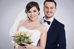 Portrait of young and cheerful just married couple