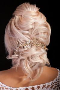Portrait of young beautiful woman with elegant coiffure. Stylish blond hair.