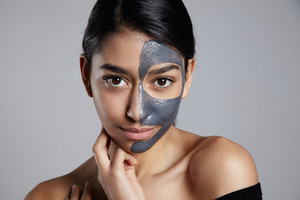 portrait of young woman with a facial mask