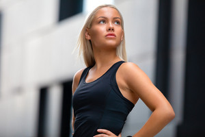 Portrati of confident Fitness Woman in Workout Outfit Standing in City