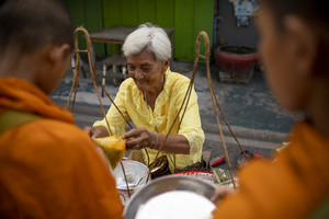 prachuap khiri khan thailand - june2,2019 : thai woman offering food to thai monk on early morning , buddhism is main religion in thailand