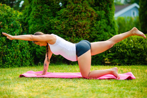 Pregnant Woman Doing Bird Dog Pose On Fitness Mat