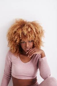 pretty black african american woman with curly blonde hair