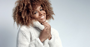 Pretty black girl with big hair posing video. feel freeze. cold season concept