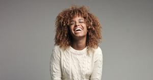 Pretty black girl with big hair posing video. laugh alot
