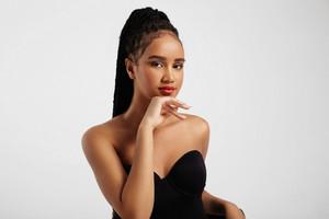 pretty black woman's portrait wears braids in pony tail
