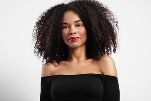 pretty black woman's portrait with curly hair