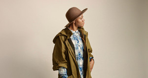 pretty mixed race woman with short hair in autumn outwear and hat