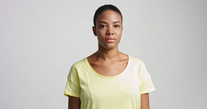 pretty mixed race woman with short hair in studio shoot