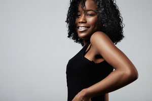 pretty smiling black woman with curly short hair