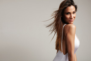 pretty spanish woman with long straight hair in studio shoot