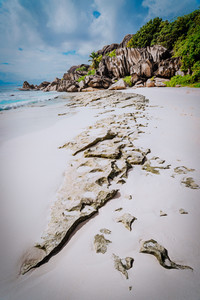 Pristine sandy beach Grand Anse in La Digue, Seychelles with its world famous granite rock formations. Nature leading line. Travel concept