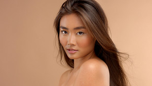 profile portrait of asian japanese thai model watching to the camera. Natural asian makeup wet shiny skin