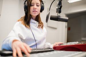 Radio Jockey Wearing Headphones In Studio