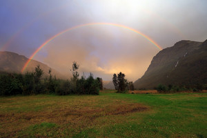 Rainbow after rain over mountain