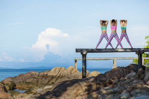RAYONG THAILAND - MAY2,2018 : three asian woman playing yoga on sea pier,yoga is popular trend for healthy lifestyle people in thailand