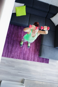 Retired old person, fitness and sports. Elderly latina woman working out at home. Active senior lady exercising and practicing sport. Recreation, lifestyle, recreational activity. High angle view