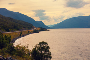 Road along fjord at sunset, Norway