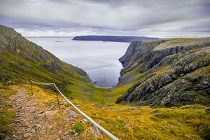 Rocky Barents sea shore. Descending footpath to beach