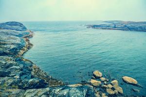 Rocky beach. Atlantic shore in the misty morning. Sea coast. Beautiful wilderness Norway