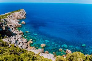 Rocky cliffs at mediterranean sea coast. Beautiful sea view coastline, vast seas